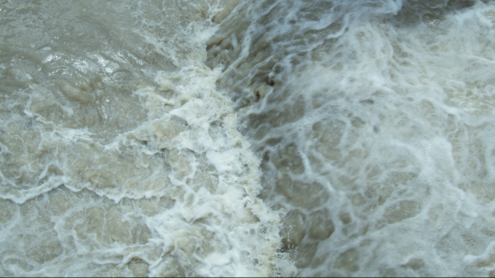 Sti image of water from film Voices and Shells by Maya Schweizer